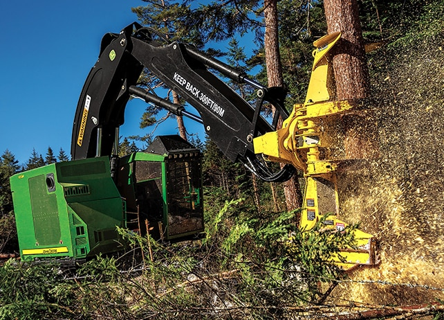 John Deere Feller Buncher with FR22B Felling Head cutting down a tree at a job site