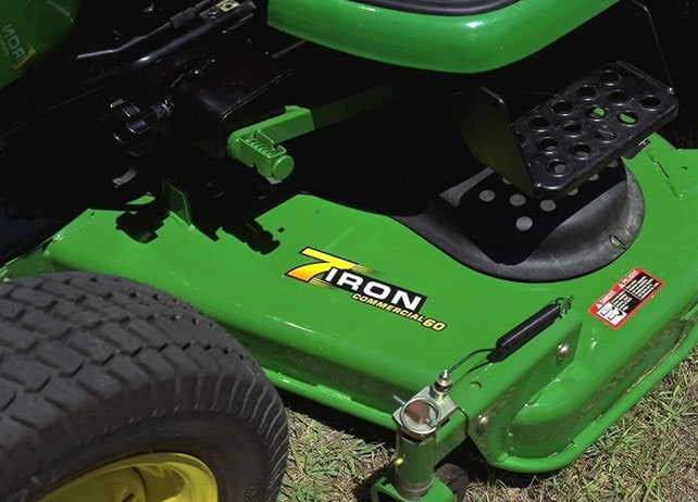 Closeup of the 60-Inch 7-Iron Mid-Mount Mower on a John Deere tractor