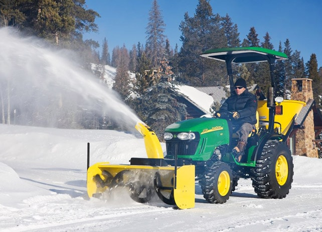 54-inch Snow Blower (2000 Series) throwing snow to clear a road
