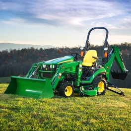 1 Family Sub-Compact Utility Tractor on a hill with blue sky in the background