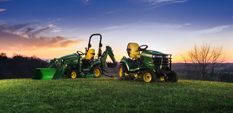 X700 Signature Series Tractor next to a 1 Family Sub-Compact Utility Tractor in front of a sunset sky