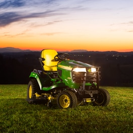 X700 Signature Series Tractor in front of a sunset sky