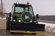 Highland Cattle Company's Gator™ XUV825i as a snow plow