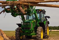 John Deere tractor lifting tree limbs
