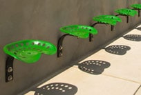 Tractor seats used as outdoor seating at Harvester Works