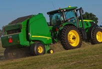 John Deere tractor with baler attachment