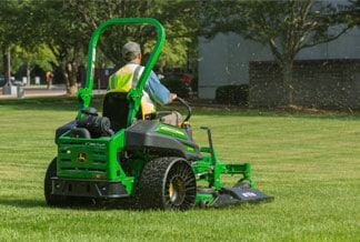 Man mows lawn using mower with X TWEEL Turf