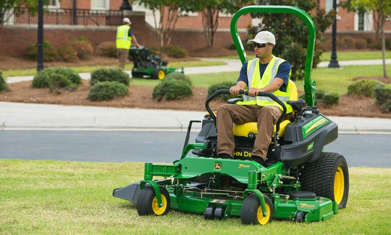 Worker using a John Deere Commercial Mower