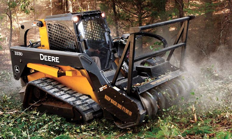John Deere Compact Track Loader with mulching head attachment working at a jobsite