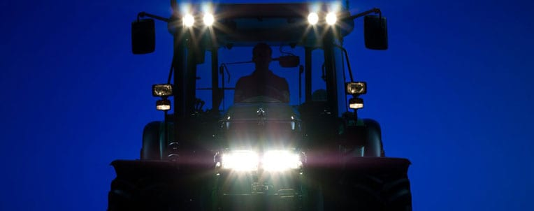 Tractor running at night with lights on