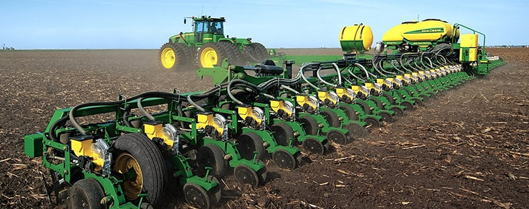 John Deere Planter in field photo