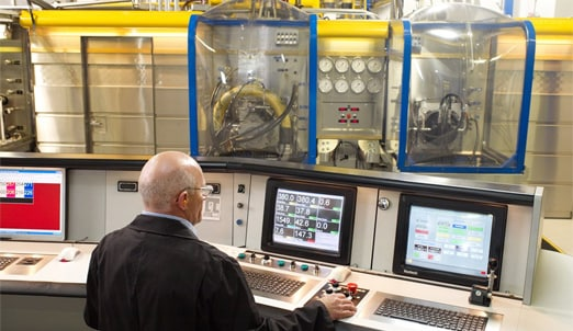 Man operating computers during hydraulic testing