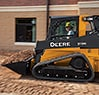 319E Compact Track Loader transporting dirt