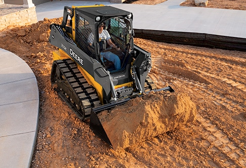 323E Compact Track Loader moving dirt