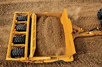Overhead view of the 1510DC Carry-All Scraper with a full load of dirt