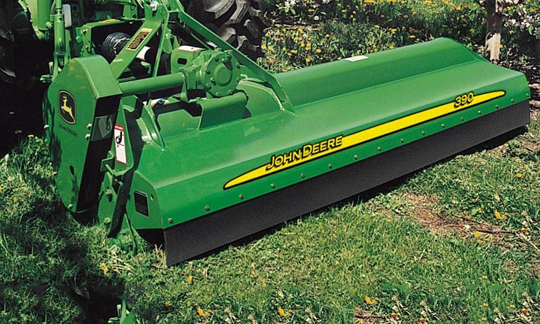 Closeup of a Flail Mower on green grass