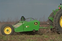 Closeup of the 120 Drawn Flail Shredder working in a field