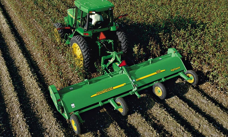 Overhead view of a John Deere tractor with Flail Shredder implement working in a field