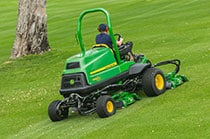 Man is operating a TerrainCut mower.