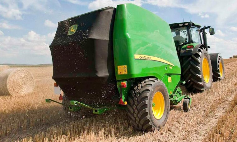 John Deere 900 Series baler at work in the field.