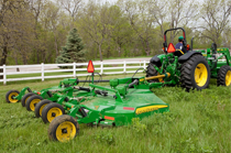 John Deere tractor with HX15 Flex-Wing Rotary Cutter in a grassy field