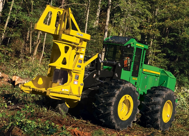 843K Wheeled Feller Buncher working in a forest