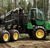 1010E Forwarder driving through a forest