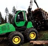 1910E Forwarder moving through the forest with a full load center