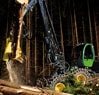 1470E Wheeled Harvester working in the forest at night