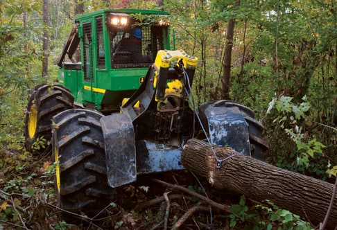 540G-III Cable Skidder pulls a log through the forest