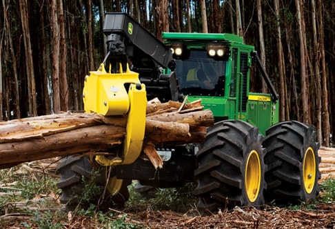648h Grapple Skidder lifts a bundle of logs