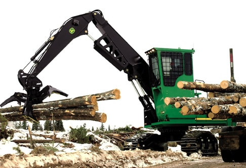 2954D Forestry Swing Machine piling logs at a job site