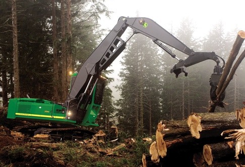 3754D Forestry Swing Machine piling logs in a misty forest