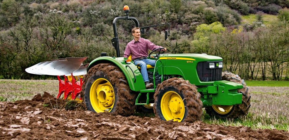Man in 5E tractor ploughing a field