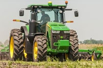 Side view of a 8245R Tractor working in a field