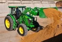 6D Tractor with loader lifting soil.