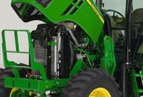 Hood up on 6D tractor showing engine.