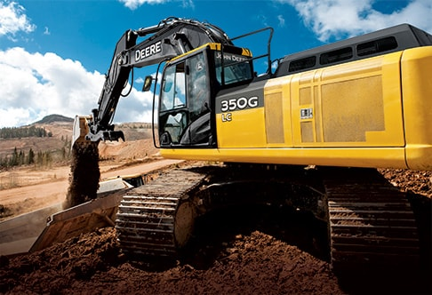 350G LC excavator filling a dump truck with dirt