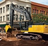 350G LC excavator digging trench at downtown street intersection