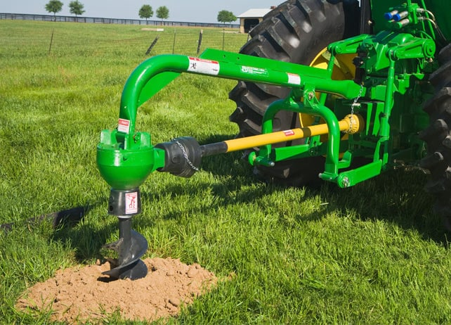 Post Hole Auger drills in pasture