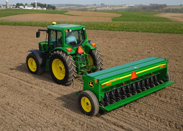 Overhead view of John Deere tractor with BD11 Series End-Wheel Grain Drill working in a field