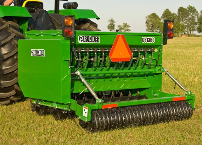 Closeup of a CS13 Series Conservation Seeder in a field