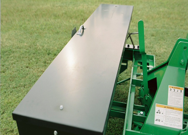 Closeup of a TR20 Series Overseeder with green grass in the background