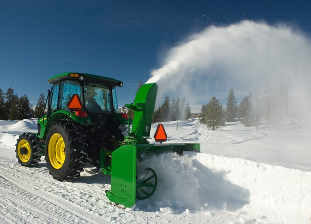 John Deere tractor using a SB13 Series 3-Point Snowblower to clear snow