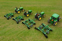 Overhead view of a line of John Deere tractors with tillage equipment