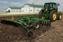 John Deere tractor using DH16 Series Disk Harrows to till a field