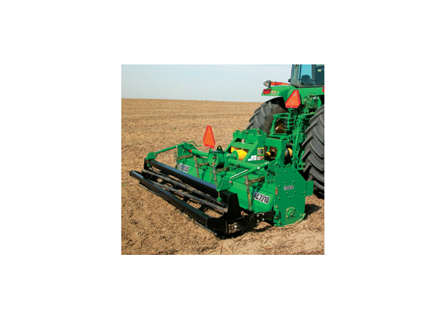 Closeup of a RC22 Series Row-Crop Tiller working in a field
