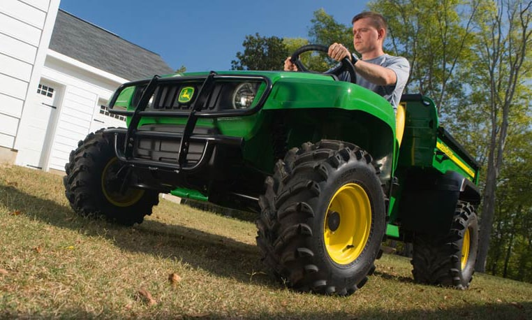 Man driving a TS Gator in his yard.