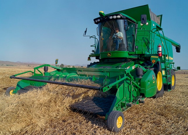 John Deere Combine with 615P Belt Pickup Platform harvesting