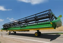 John Deere Draper being transported on a trailer